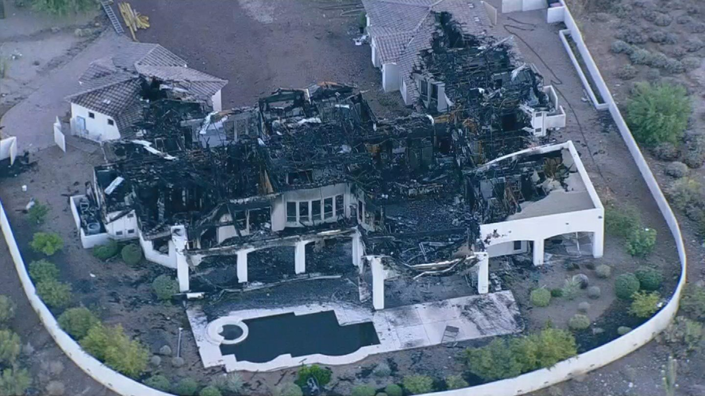A multi-million dollar home is a complete loss after a first-alarm fire broke out overnight in Scottsdale. (Source: 3TV/CBS 5)