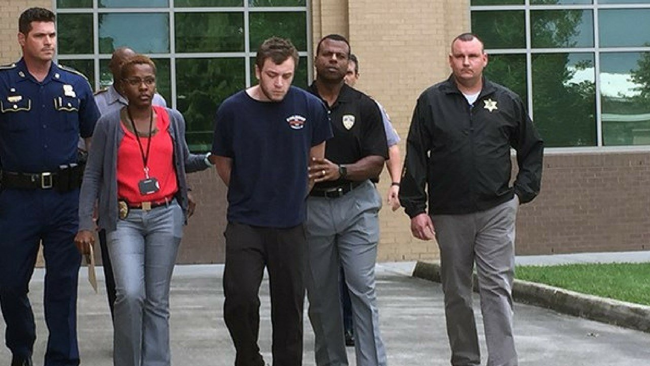 Kenneth Gleason being walked out of VCU on Sept. 19, 2017. (Source: WAFB)