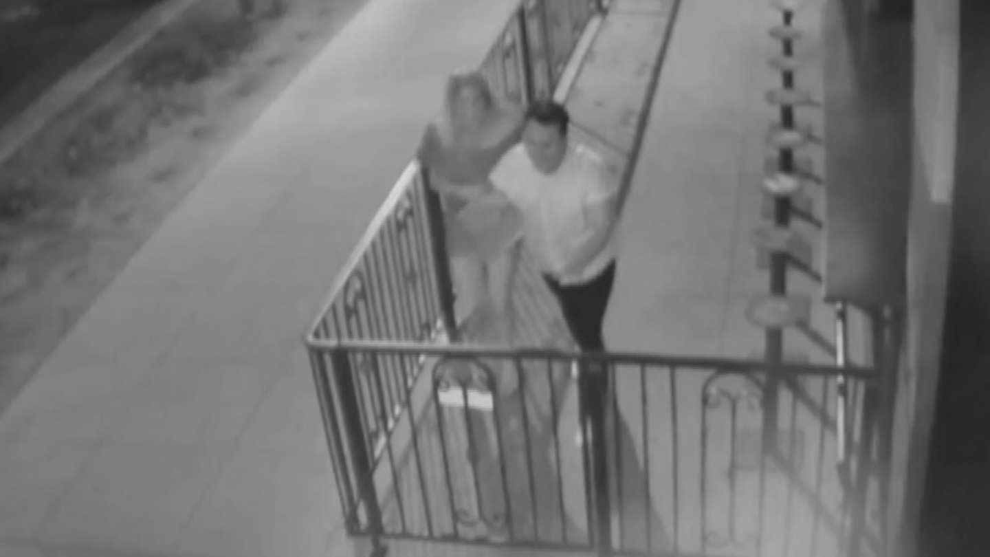she and the man take the painting and walk out the door. (Source: 3TV/CBS 5)