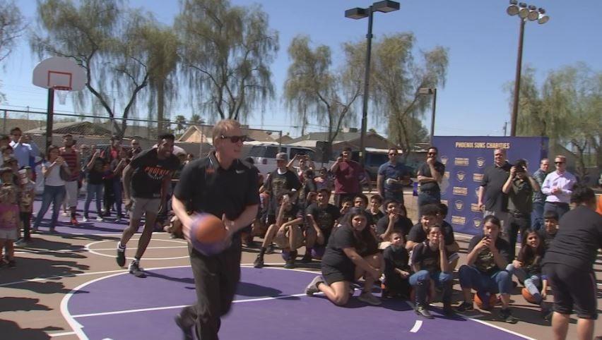 Suns owner Robert Sarver throws and alley oop to Derrick Jones Jr. on Neighborhood Missions new court. (Source: 3TV/CBS 5)