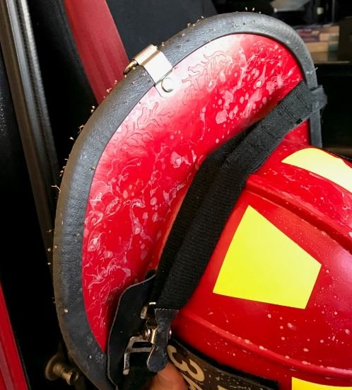 Dozens of stingers remain in a helmet worn by one of the firefighters who responded to the swarm. (Source: Northwest Fire Department)