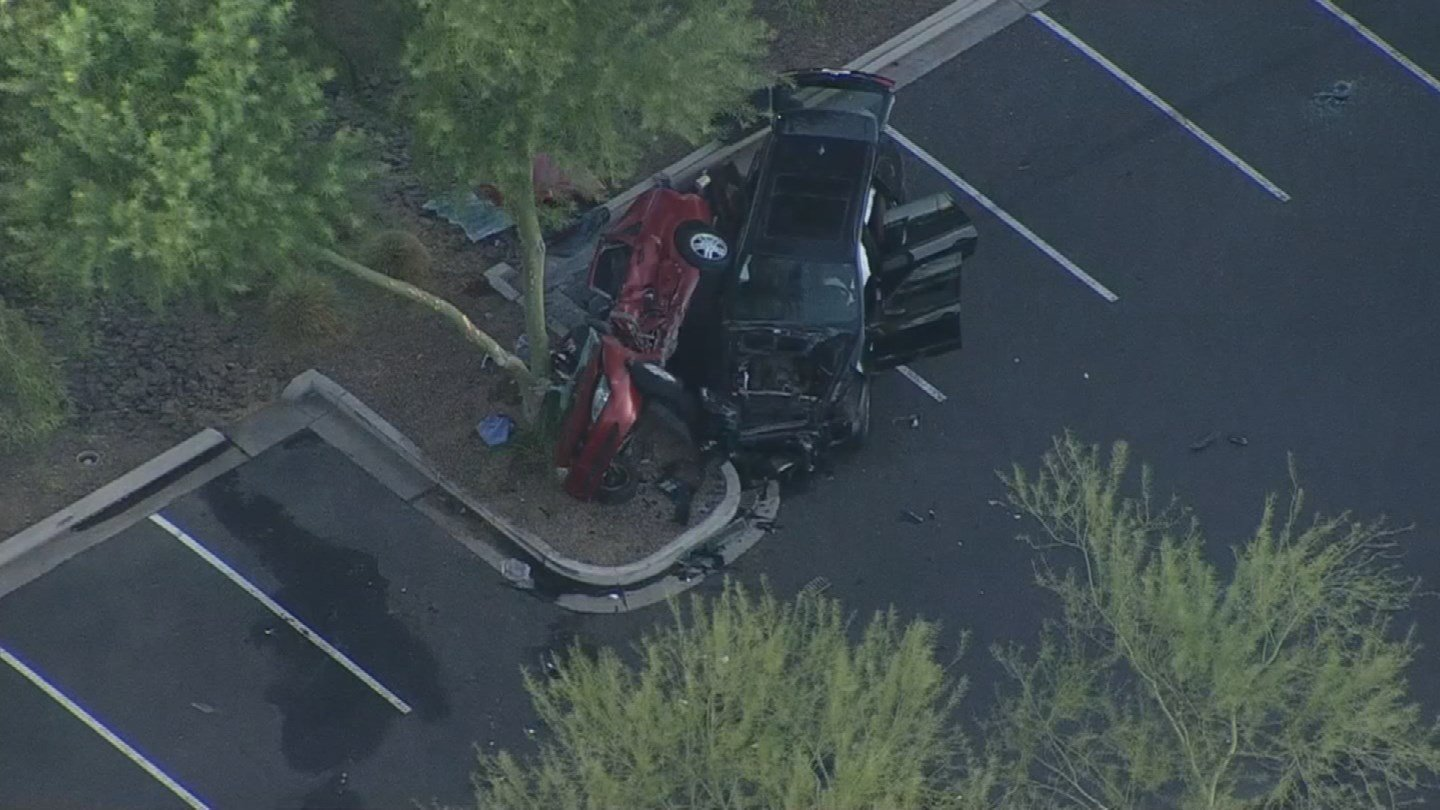 Around 2 a.m., a man purposely collided with another man's vehicle in the parking lot of theTempe Marketplace, pinning it against a tree. (Source: 3TV/CBS 5)