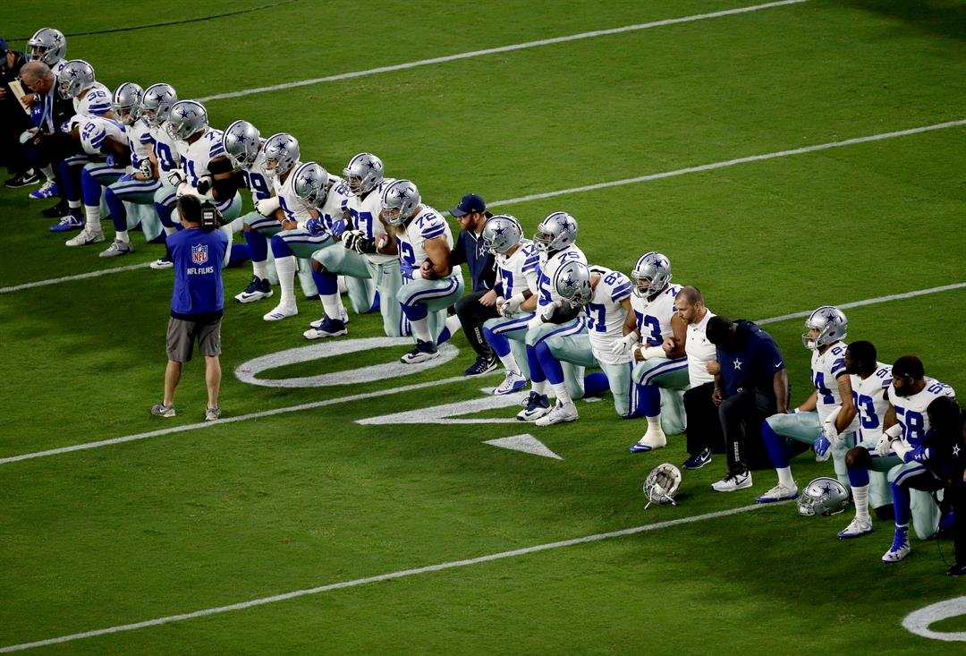 The Dallas Cowboys take a knee prior to the national anthem prior to an NFL football game against the Arizona Cardinals, Monday, Sept. 25, 2017, in Glendale, Ariz. (Source: AP Photo/Matt York)