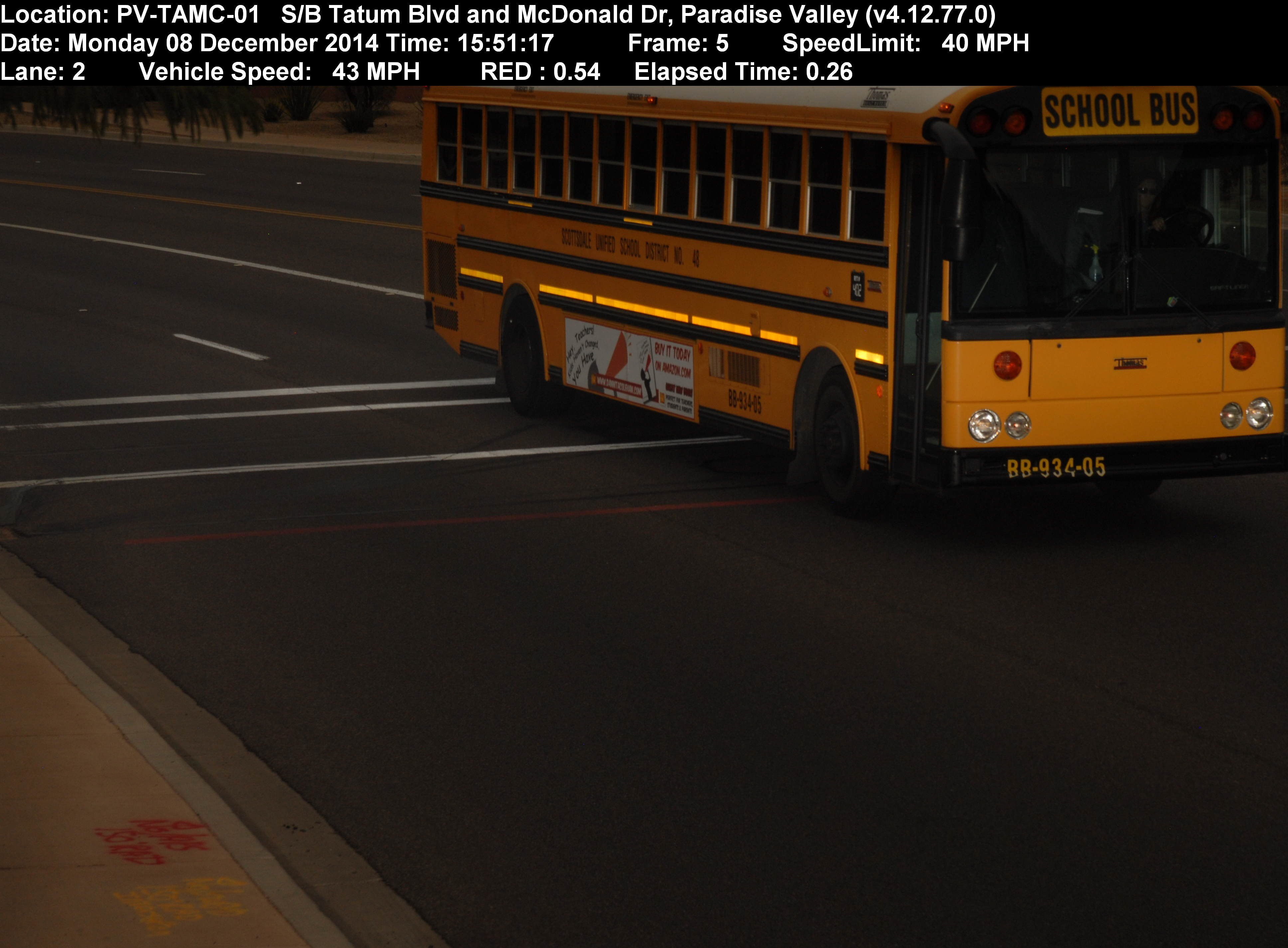 A Scottsdale Unified School bus runs a red light in December 2014. (Source: 3TV/CBS 5 public records request)