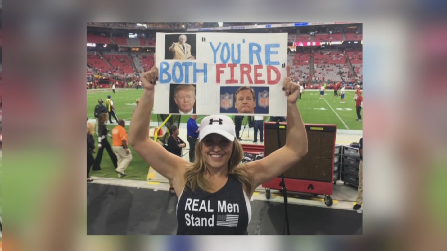 Brooke Barr holds a sign Ashley Fritz said she made in response to the comments President Trump made last week about firing players who kneel during the national anthem.(Source: 3TV/CBS 5)
