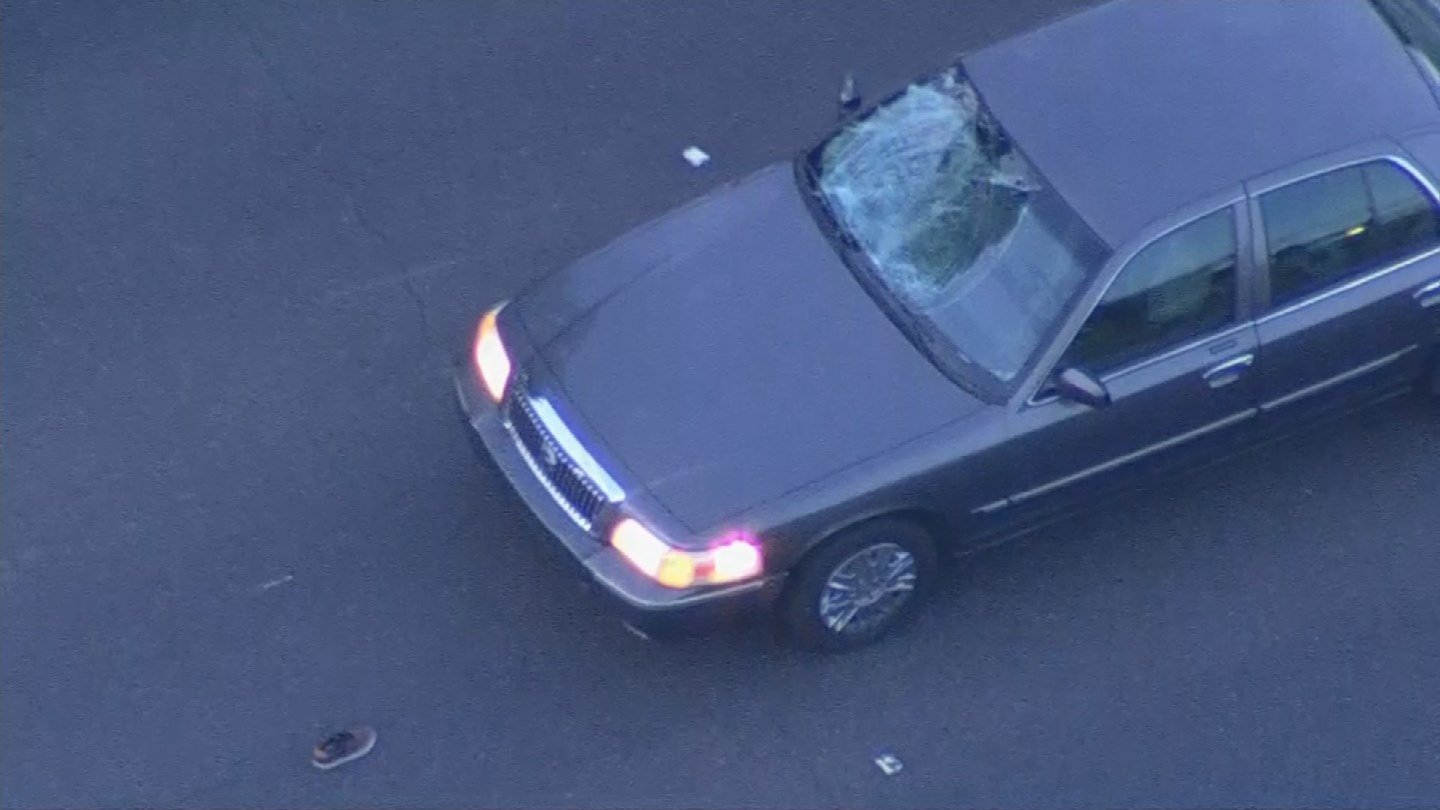 The windshield of the gray sedan caved in from the impact of the bicyclist. (Source: 3TV/CBS 5)