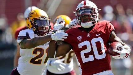 Stanford running back Bryce Love (20) runs for a touchdown past Arizona State defensive back Chad Adams (21) during the first half of an NCAA college football game Saturday, Sept. 30, 2017, in Stanford, Calif. (AP Photo/Marcio Jose Sanchez)