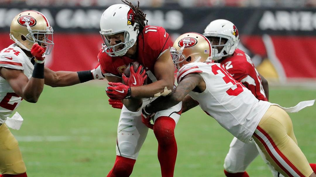 Arizona Cardinals wide receiver Larry Fitzgerald (11) runs as San Francisco 49ers cornerback Dontae Johnson (36) and defensive back K'Waun Williams (24) defend during the first half of an NFL football game, Oct. 1, 2017. (AP Photo/Rick Scuterti)