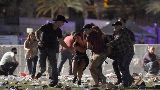 Shooting victims being aided in Las Vegas. (Source: Associated Press)