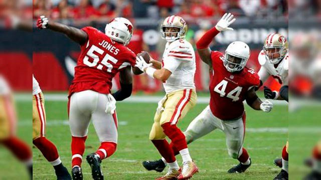 AP Photo San Francisco 49ers quarterback Brian Hoyer looks to throw as Arizona Cardinals outside linebacker Markus Golden (44) and outside linebacker Chandler Jones (55) pursue during the second half. (Source: AP Photo)