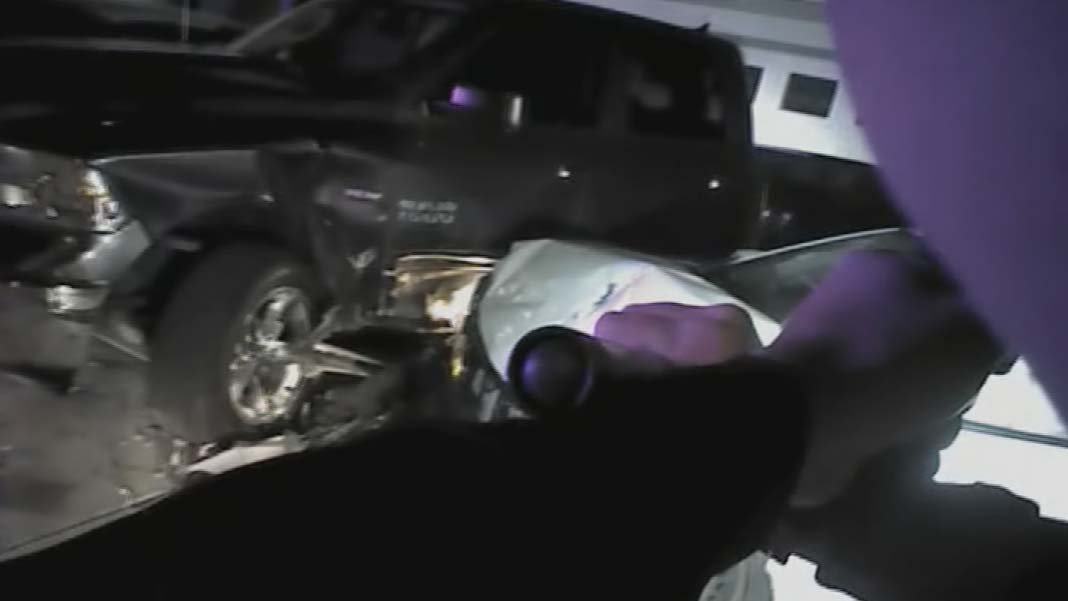 McGonigle, gun drawn, approached Adame's wrecked vehicle with Adame inside. (Source: Surprise Police Dept.)