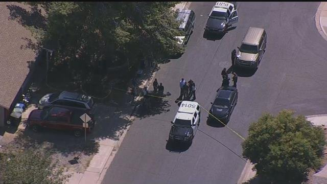 Police on the scene of officer-involved shooting in the neighborhood southwest of Rio Salado Parkway and Alma School Road. (Source: 3TV/CBS5)