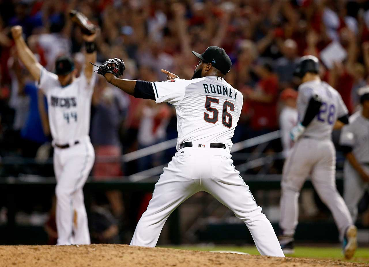 Arizona Diamondbacks relief pitcher Fernando Rodney (56) celebrates after the National League wild-card playoff baseball game against the Colorado Rockies, Wednesday, Oct. 4, 2017, in Phoenix. (Source: AP Photo/Ross D. Franklin)