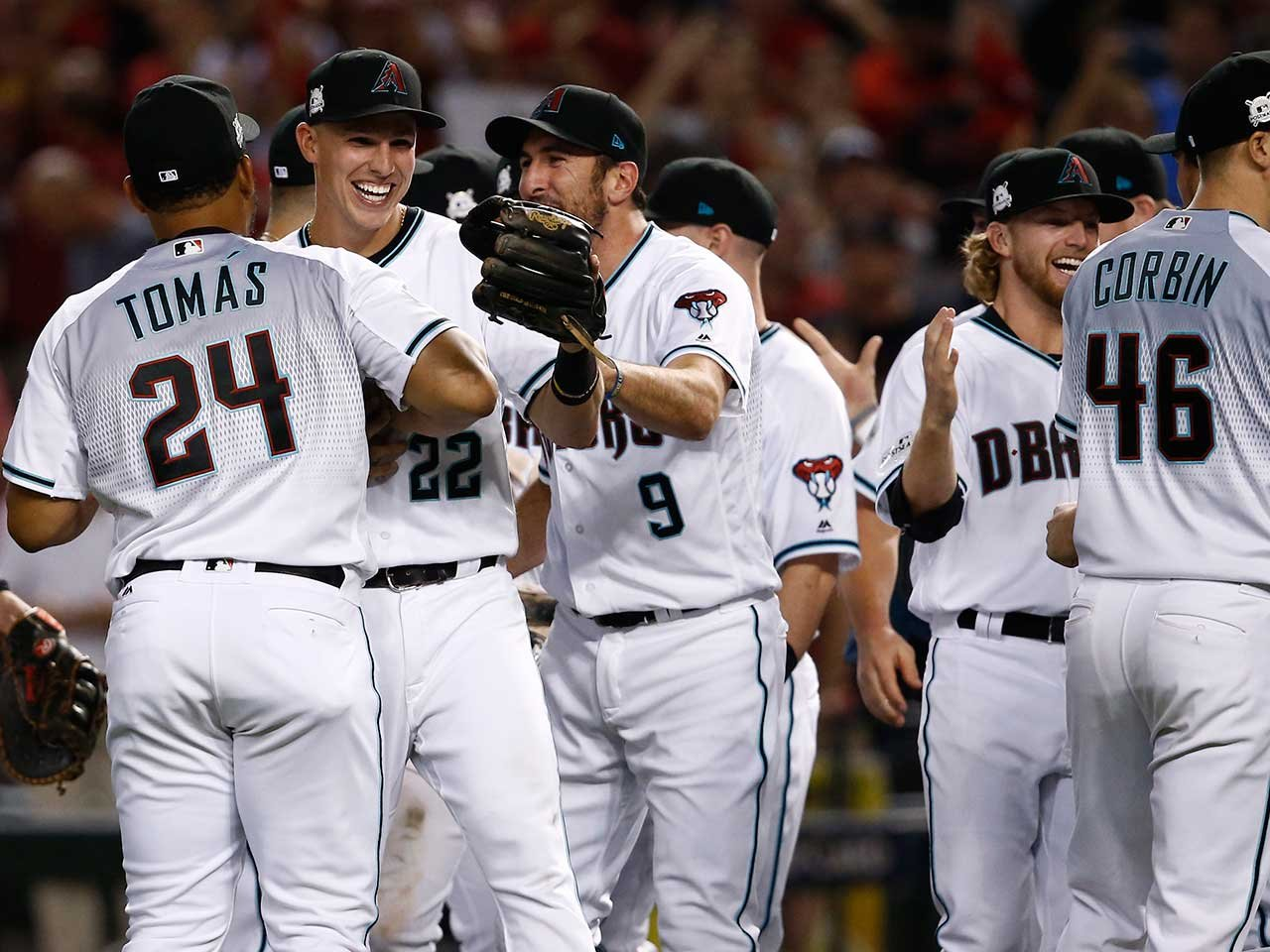 The Arizona Diamondbacks celebrate after the National League wild-card playoff baseball game against the Colorado Rockies, Wednesday, Oct. 4, 2017, in Phoenix. (Source: AP Photo/Ross D. Franklin)