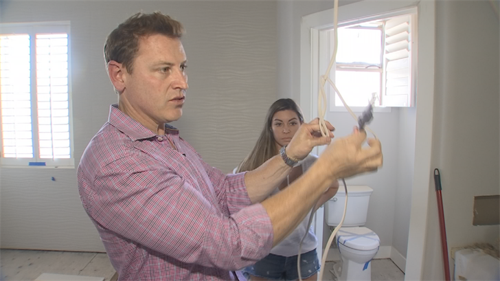 Exposed wiring and allegations of shoddy work are what Kira Girard has to live withafter recently moving into her newly remodeled Scottsdale home. (Source: 3TV)