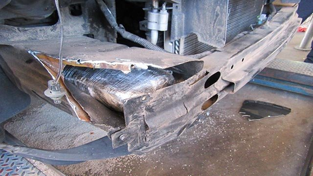 Federal officers alerted by a drug-sniffing dog found 26 pounds (12 kilograms) of heroin hidden in the bumper of an SUV at a border crossing point in Nogales. (Source: U.S. CBP)