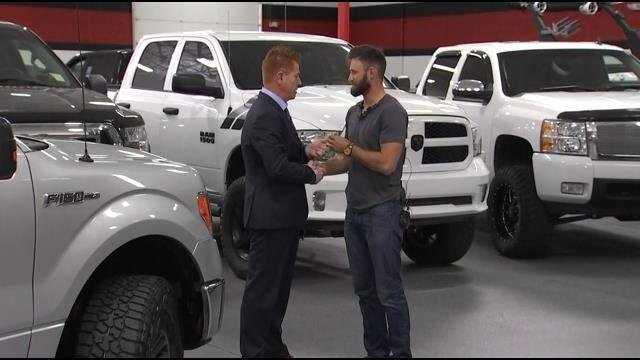 Shane Beus, owner of B5 Motors in Gilbert, presented Taylor Winston with the keys to a truck Monday morning. (Source: 3TV/CBS 5)