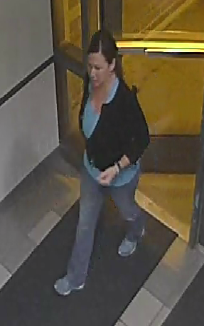 The photos show Cathryn Gorospe going into the Coconino County Jail to bail out Charlie Malzahn on Friday, police said. (Source: Flagstaff Police Department)