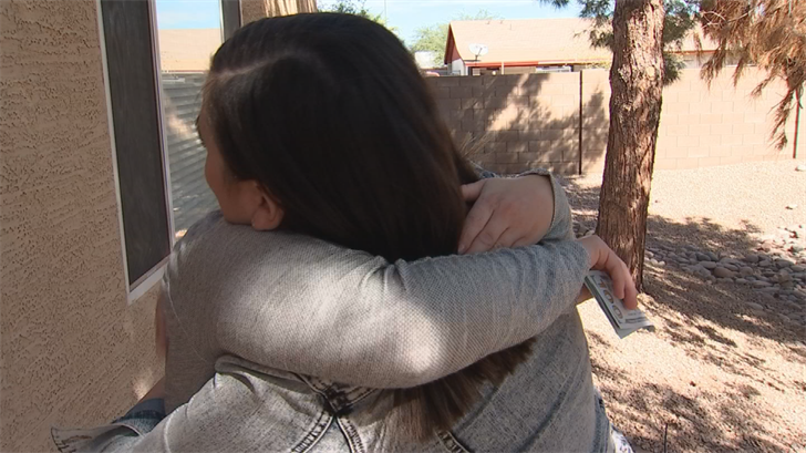 A CBS 5 news crew was there when Miller surprised Kellogg and presented her with $500. (Source: CBS 5)