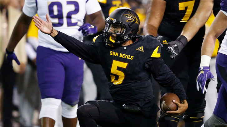 ASU QB Manny Wilkins signals a first down (AP Photo/Ross D. Franklin)