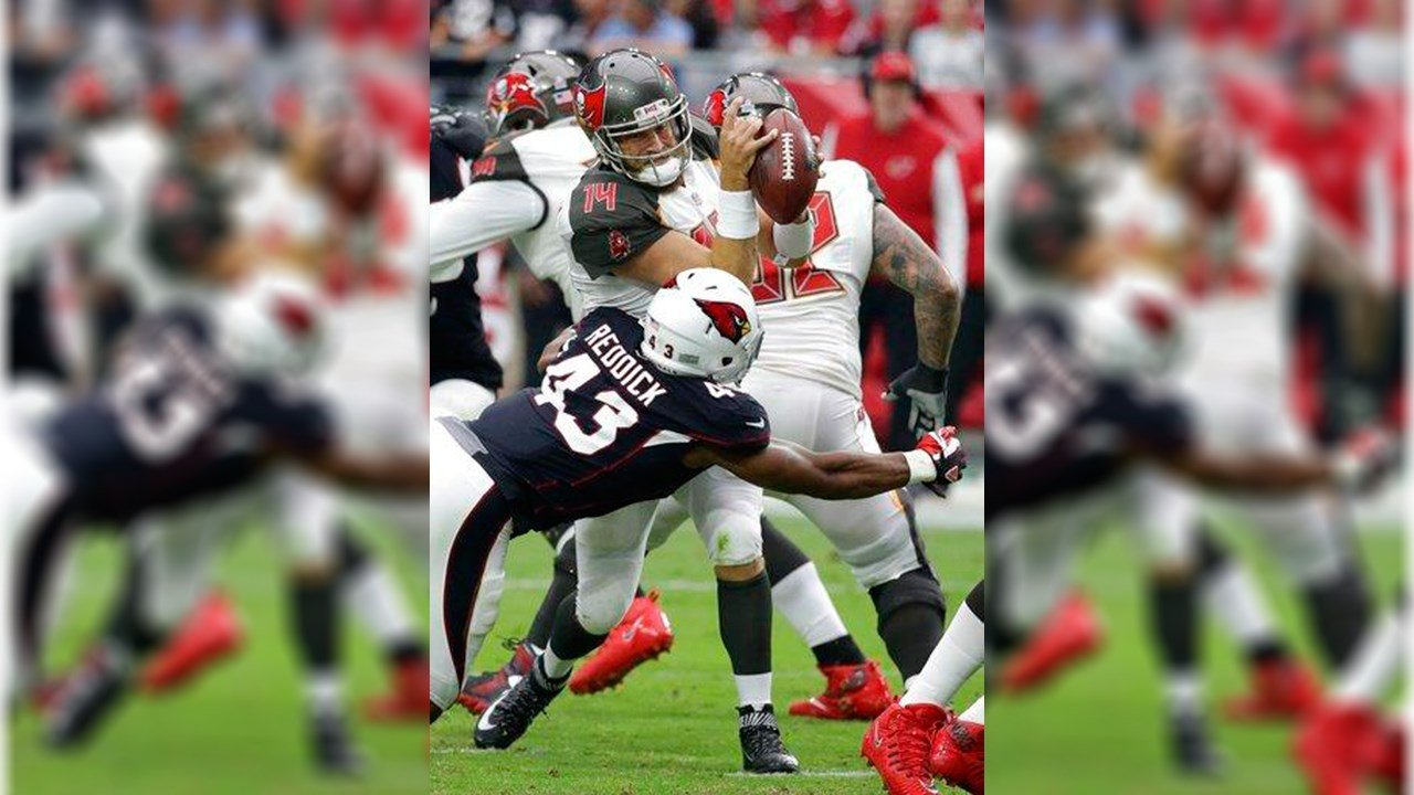 Arizona Cardinals inside linebacker Haason Reddick (43) hits Tampa Bay Buccaneers quarterback Ryan Fitzpatrick (14) during the first half of an NFL football game, Sunday, Oct. 15, 2017, in Glendale, Ariz. (AP Photo/Rick Scuteri)