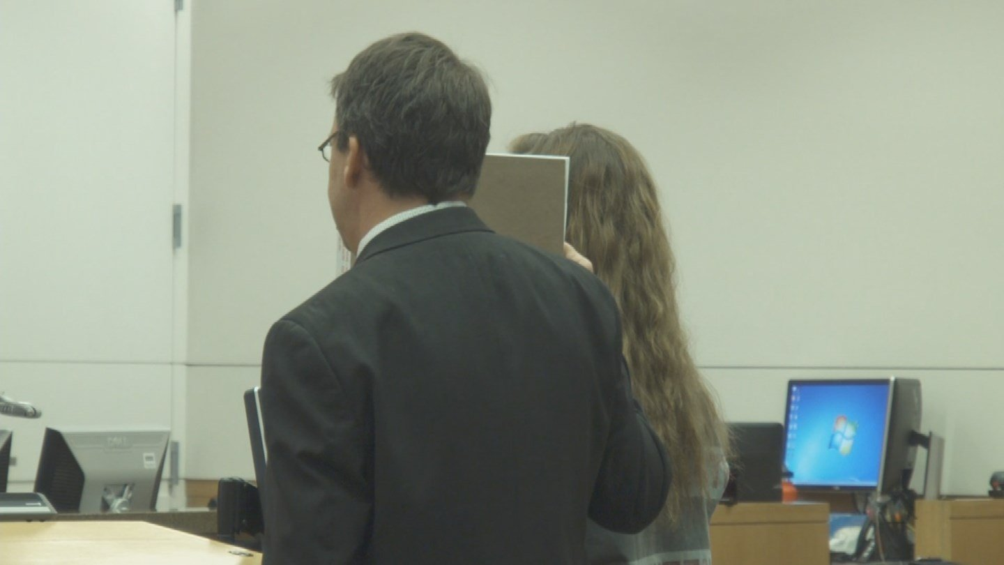 The lawyer for Madeline Jones, 19, blocked her face so the media could not get a clear shot of her during her arraignment Friday morning. (Source: 3TV/CBS 5)