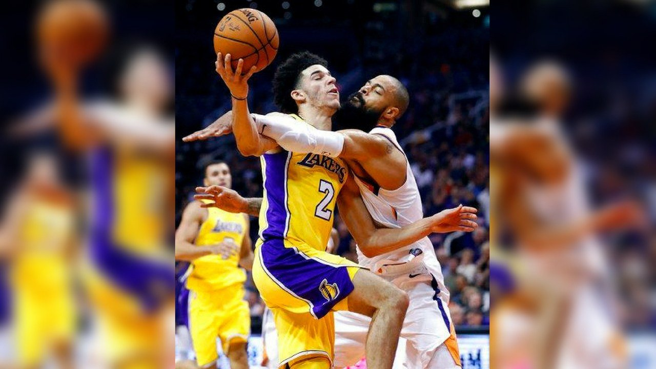 Phoenix Suns center Tyson Chandler fouls Los Angeles Lakers guard Lonzo Ball (2) during the first half of an NBA basketball game, Friday, Oct. 20, 2017, in Phoenix. (AP Photo/Matt York)