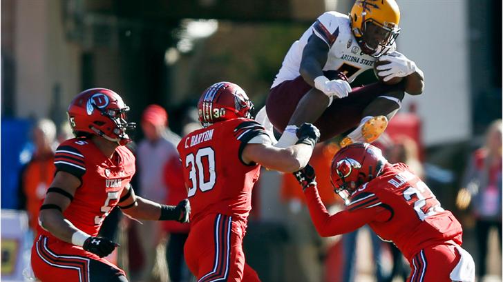 ASU running back Kalen Ballage hurdles over defenders (AP Photo/Rick Bowmer)