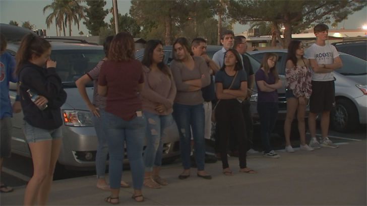 About 50 people held hands and said a prayer. (Source: 3TV/CBS 5)
