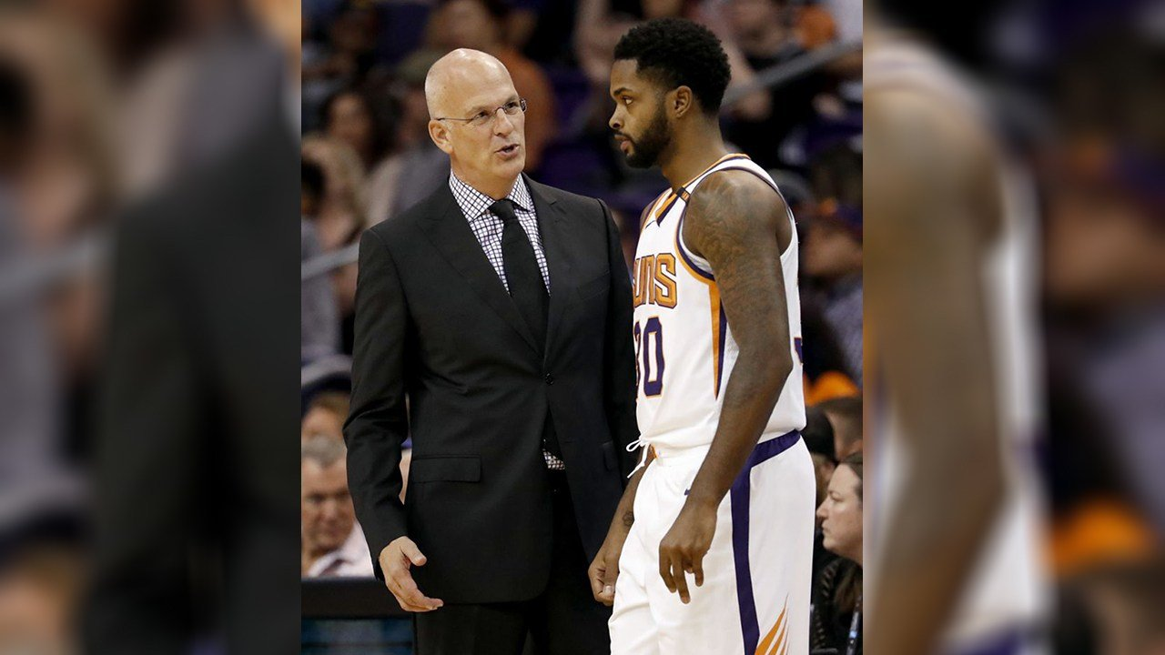 Phoenix Suns head coach Jay Triano speaks with Phoenix Suns guard Troy Daniels (30) during the first half of an NBA basketball game against the Sacramento Kings, Monday, Oct. 23, 2017, in Phoenix. (Source: AP Photo/Matt York)