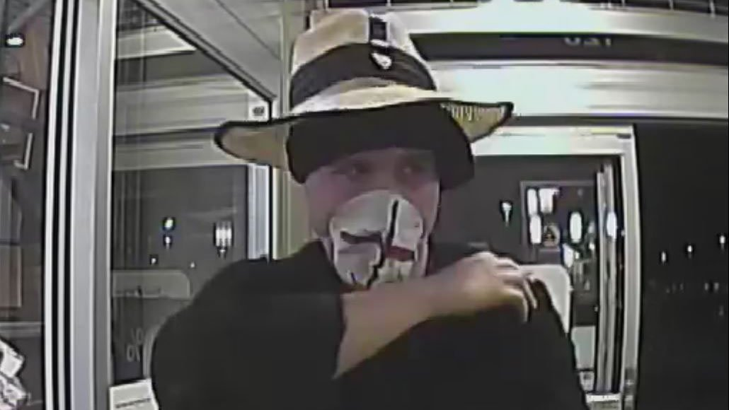 "The ""Fashion Forward Bandit"" entering a Valley business. (Source: FBI Phoenix Field Office)"
