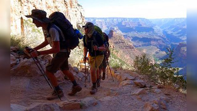FILE - In this July 27, 2015, file photo, a long line of hikers head out of the Grand Canyon along the Bright Angel Trail at Grand Canyon National Park, Ariz. (Source: AP Photo/Ross D. Franklin, File)