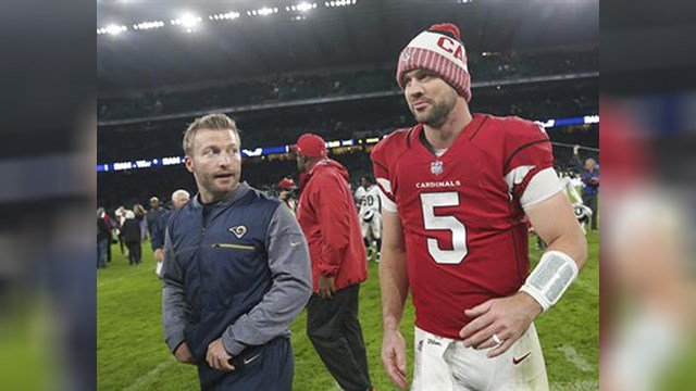 FILE - In this Sunday Oct. 22, 2017, file photo, Arizona Cardinals quarterback Drew Stanton (5) walks off the field with Los Angeles Rams head coach Sean McVay after an NFL football game at Twickenham Stadium. (Source: AP Photo/Tim Ireland, File)