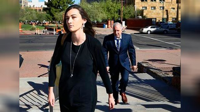 Laney Sweet, left, widow of Daniel Shaver, arrives at Maricopa County Superior Court with attorney Mark Geragos, right, for the opening statements in the trial of former Mesa, Ariz., police officer Philip Brailsford. (Source: AP Photo/Ross D. Franklin)