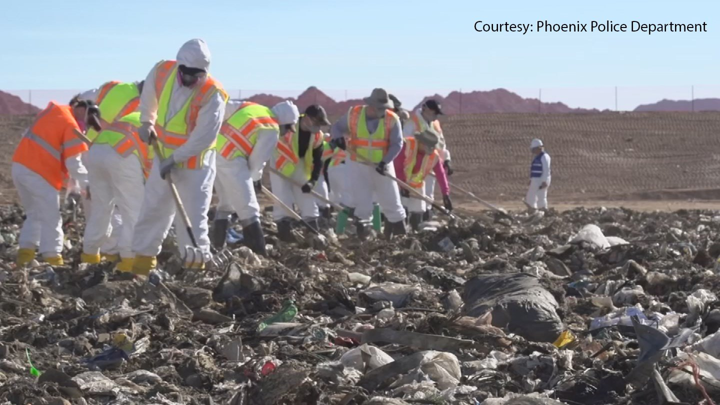 Searchers must carefully piece through garbage and pile it into a dump truck to be weighed. (Source: Phoenix Police Department)