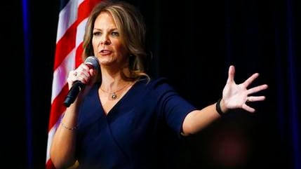 In a Tuesday, Oct. 17, 2017 photo, former Republican Arizona state Sen. Kelli Ward smiles as she is greeted by supporters at a campaign fundraiser, in Scottsdale, Ariz. (AP Photo/Ross D. Franklin)