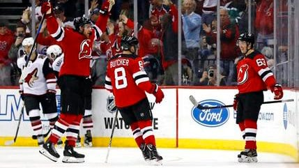 New Jersey Devils' Jesper Bratt (63) celebrates scoring a goal with teammates against the Arizona Coyotes during the third period of an NHL hockey game, Saturday, Oct. 28, 2017, in Newark, N.J. The Devils won 4-3. (Source: AP Photo/Adam Hunger)