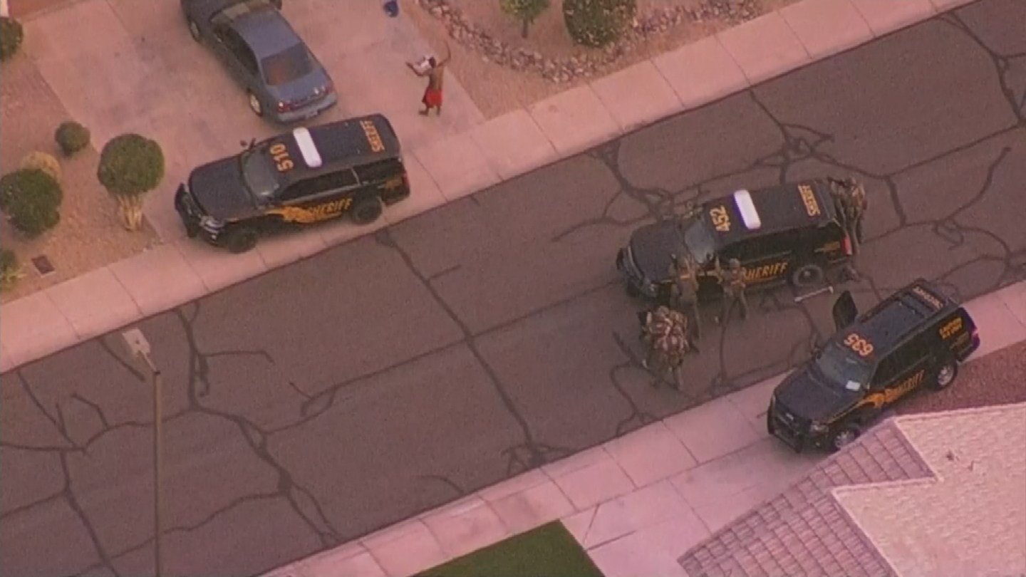 The suspect exited the home with his hands up and without incident. (Source: 3TV/CBS 5)