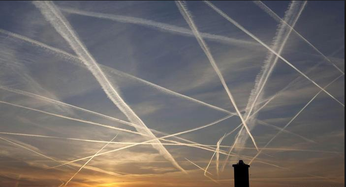 Sky crisscrossed with contrails. (Source: NASA)