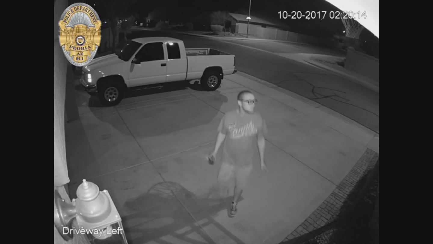 Police believe this man started a fire at a pickup truck in the driveway. (Source: Peoria Police Department)