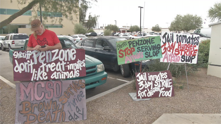 Protesters held signs outside of the Durango Jail on Tuesday afternoon. (Source: 3TV/CBS 5)