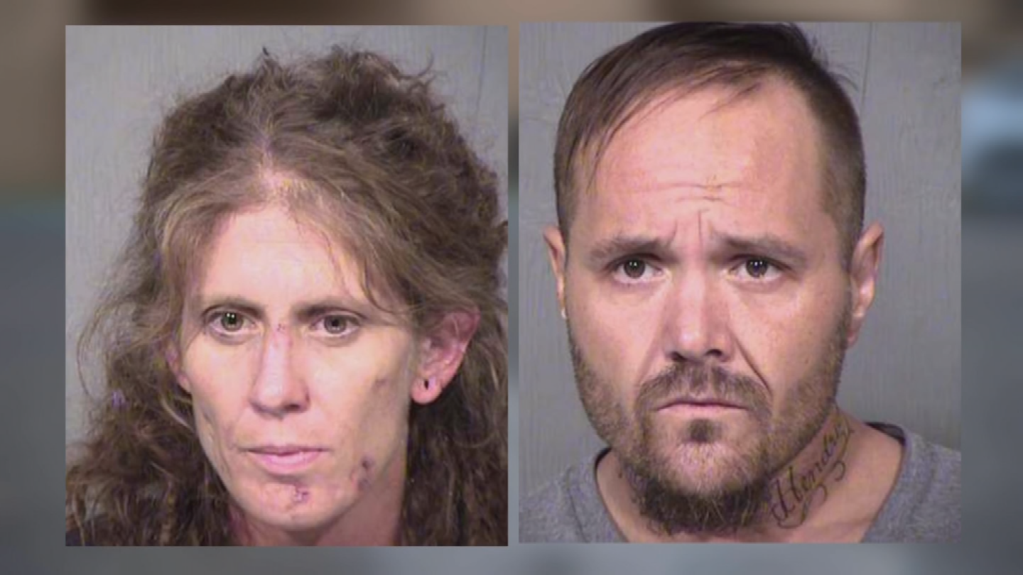 The man and woman inside the car were identified as Stacy and Gregory Dobbs. (Source: 3TV/CBS 5)