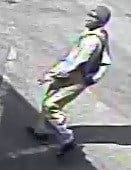 The suspect was seen as a black male in a tan jumpsuit with a black beanie, eyeglasses and a black and white backpack. (Source: Silent Witness)