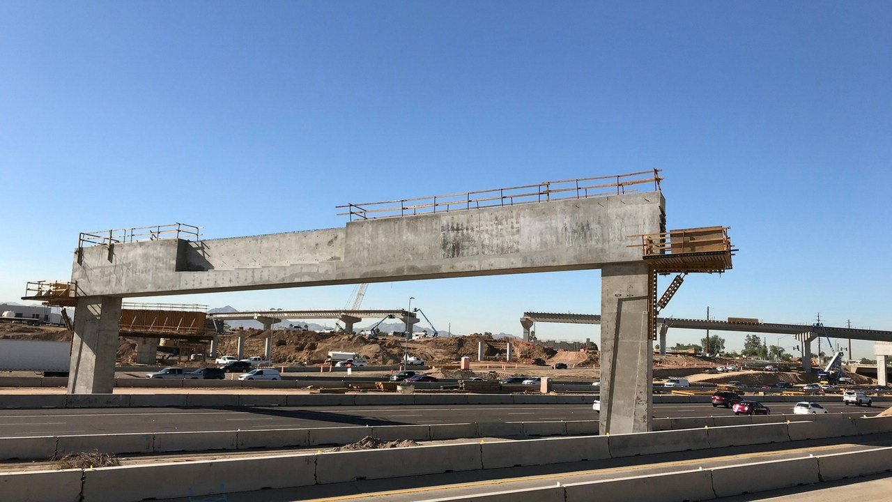 The I-10 Flyover Bridge is seen in the background.(Source: Arizona Department of Transportation)