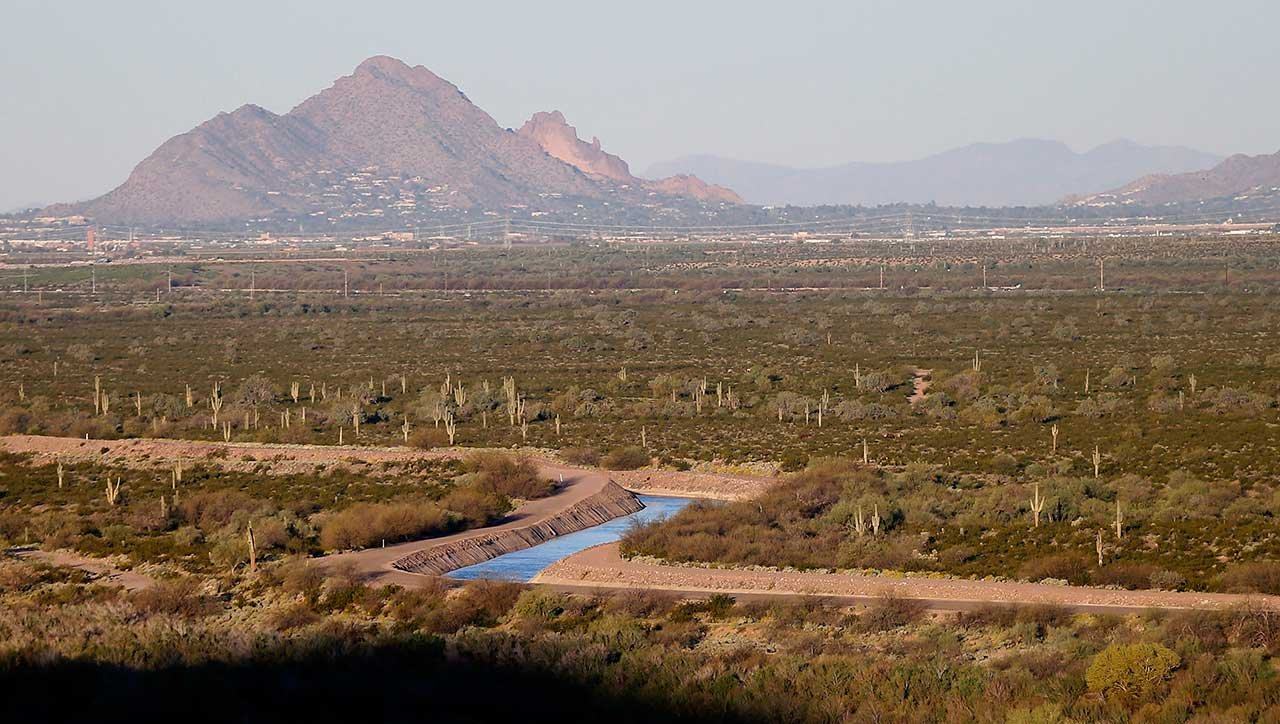 The Central Arizona Project (CAP) canal cuts through the desert, Friday, M