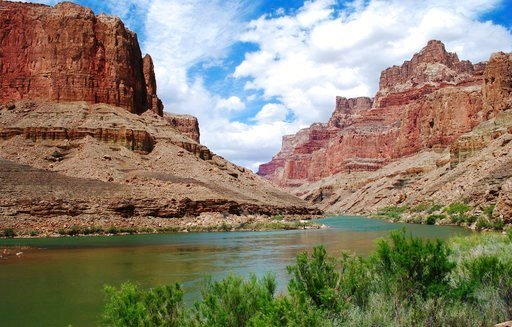 This undated photo provided by Confluence Partners, LLC, shows a view upstream on the Colorado River in the Grand Canyon at the site for a proposed aerial tram. Navajo Nation lawmakers will consider a plan. Confluence Partners, LLC via AP)