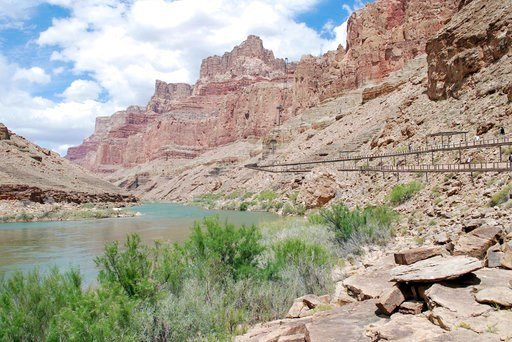 This artist rendering provided by Confluence Partners, LLC, depicts a proposed aerial tramway, at right, that would ferry tourists from the cliff tops of the east rim of the Grand Canyon to the water's edge of the Colorado River. (Confluence Partners, LLC