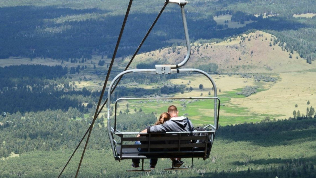 Visitors enjoying the view from Arizona Snowbowl ski lift. (SOURCE: Arizona Snowbowl)