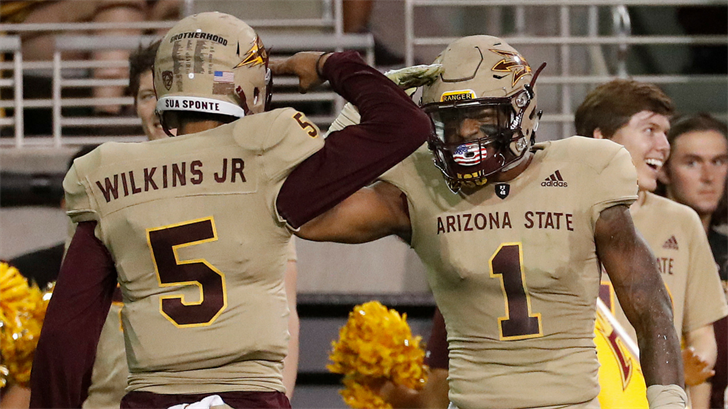 Manny Wilkins and N'Keal Harry celebrate a touchdown (AP Photo/Matt York)