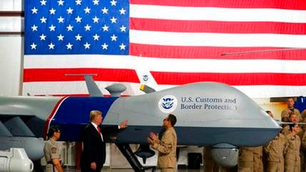 In this Aug. 22, 2017, file photo, President Donald Trump touches a drone during a tour of U.S. Customs and Border Protection Border equipment at their airport hanger at Marine Corps Air Station Yuma in Yuma, Ariz. (Source: AP Photo/Alex Brandon, File)